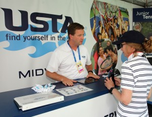 John Kolner, Director of Membership Marketing for the USTA Midwest Section, assists a USTA member.